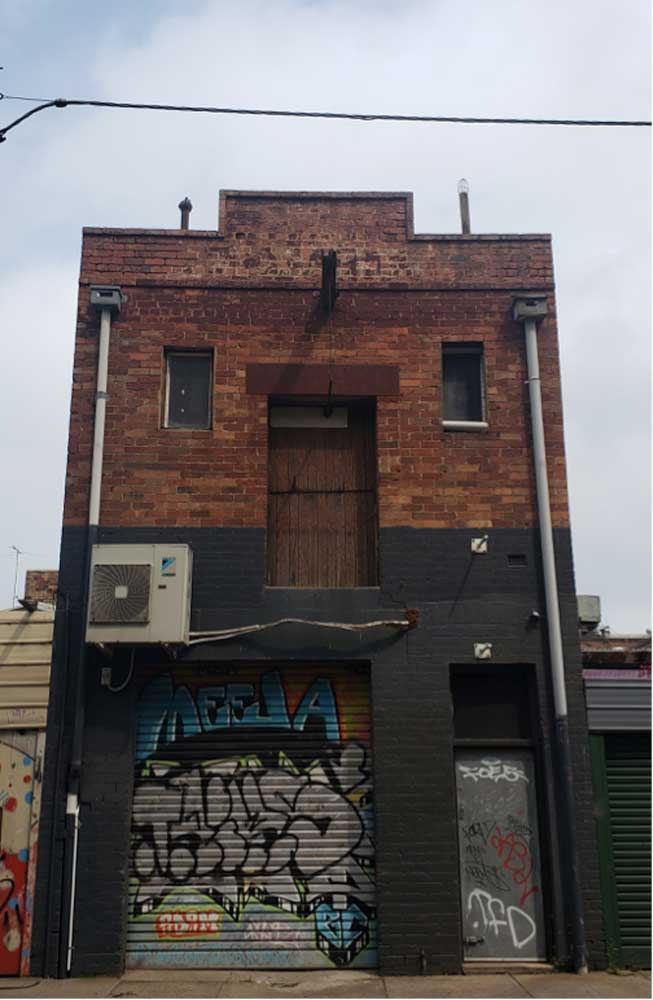 The back of the store as it appears today. The door and pulley system at the top of the building still remain